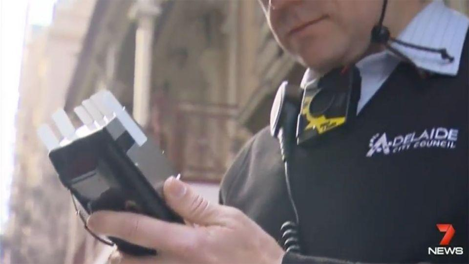 Adelaide parking inspectors were among the first to undertake a trial with the body worn cameras after officers said they felt unprotected. Source: 7 News