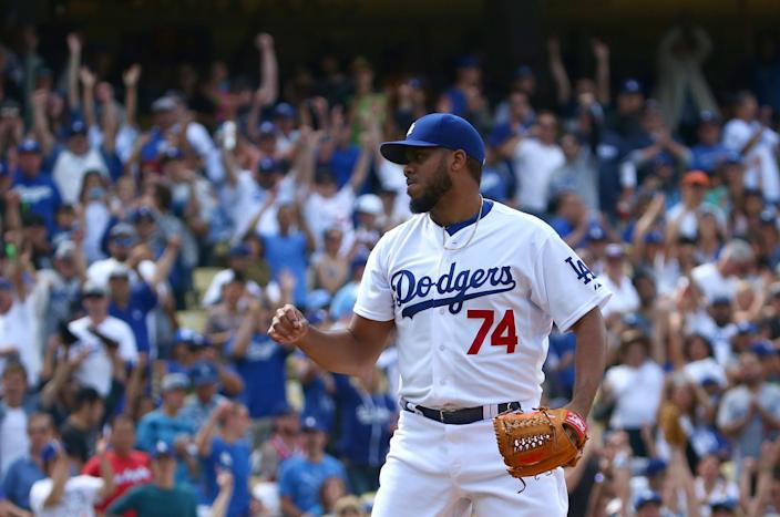 """Kenley Jansen reacts after striking out Colorado's Wilin Rosario for the last out in 1-0 Dodgers win on May 17, 2015. <span class=""""copyright"""">(Victor Decolongon / Getty Images)</span>"""