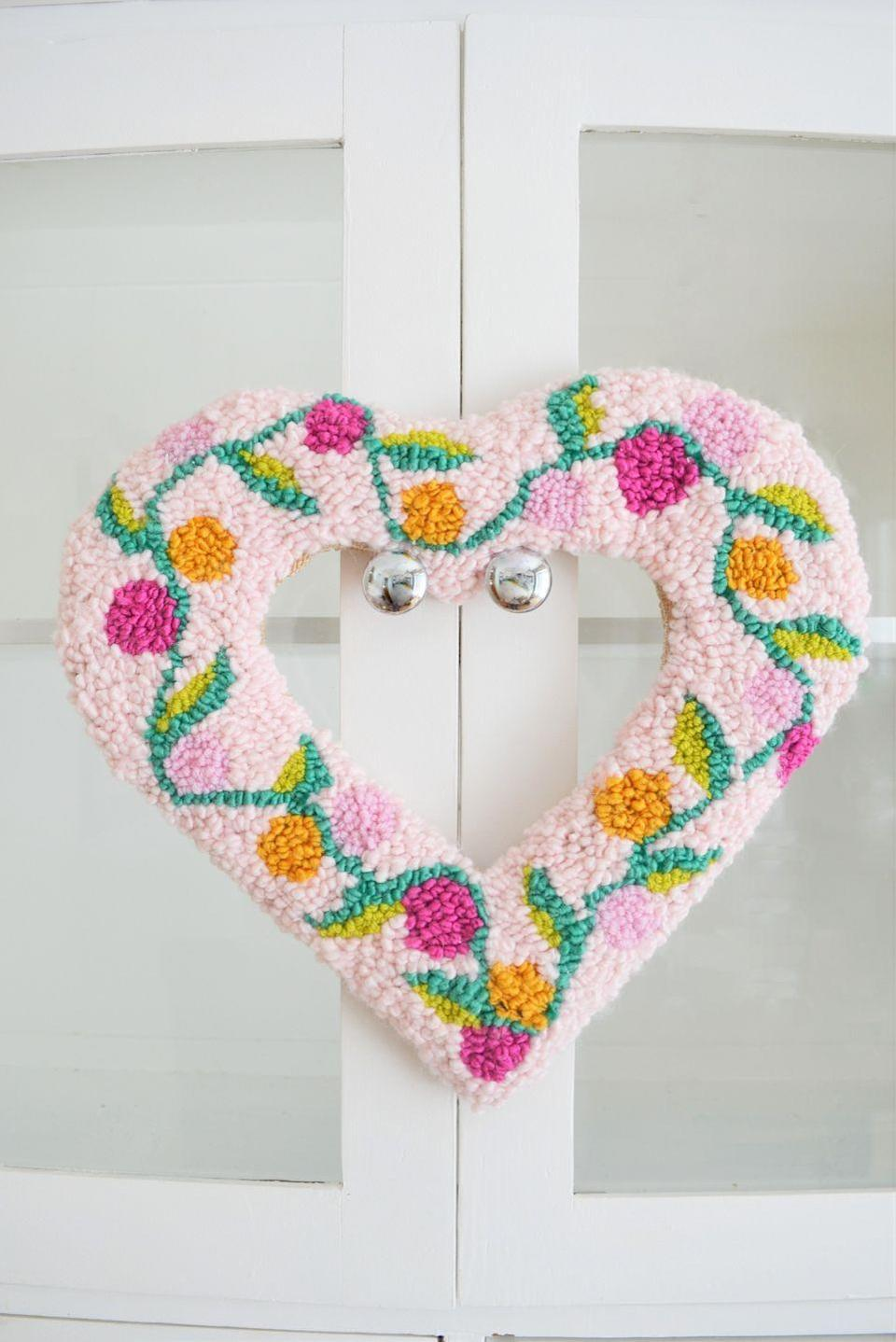 """<p>Rug hooking isn't just for rugs! In fact, it looks pretty amazing when applied to a heart-shaped wreath form that'll look lovely all spring.</p><p><strong>Get the tutorial at <a href=""""https://makingthingsisawesome.com/rug-hooking-heart-wreath-tutorial/"""" rel=""""nofollow noopener"""" target=""""_blank"""" data-ylk=""""slk:Making Things Is Awesome"""" class=""""link rapid-noclick-resp"""">Making Things Is Awesome</a>.</strong></p><p><a class=""""link rapid-noclick-resp"""" href=""""https://go.redirectingat.com?id=74968X1596630&url=https%3A%2F%2Fwww.walmart.com%2Fip%2FPoly-Fil-Extra-Loft-Queen-Size-Bonded-Polyester-Quilt-Batting-90-x-108-1-Each%2F46021937&sref=https%3A%2F%2Fwww.thepioneerwoman.com%2Fhome-lifestyle%2Fcrafts-diy%2Fg35698457%2Fdiy-easter-wreath-ideas%2F"""" rel=""""nofollow noopener"""" target=""""_blank"""" data-ylk=""""slk:SHOP QUILT BATTING"""">SHOP QUILT BATTING</a></p>"""