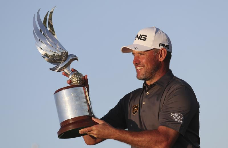 England's Lee Westwood holds the trophy after he won the Abu Dhabi Championship golf tournament in Abu Dhabi, United Arab Emirates, Sunday, Jan. 19, 2020. (AP Photo/Kamran Jebreili)