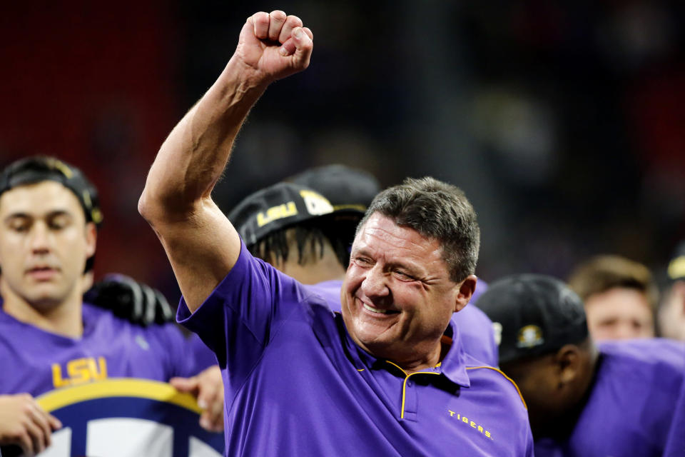 FILE - In this Dec. 7, 2019, file photo, LSU coach Ed Orgeron celebrates after the team's win over Georgia in an NCAA college football game for the Southeastern Conference championship, in Atlanta. Top-ranked LSU has the SEC's coach of the year in Ed Orgeron, as The Associated Press All-Southeastern Conference football team was announced Monday, Dec. 9, 2019. (C.B. Schmelter/Chattanooga Times Free Press via AP, File)