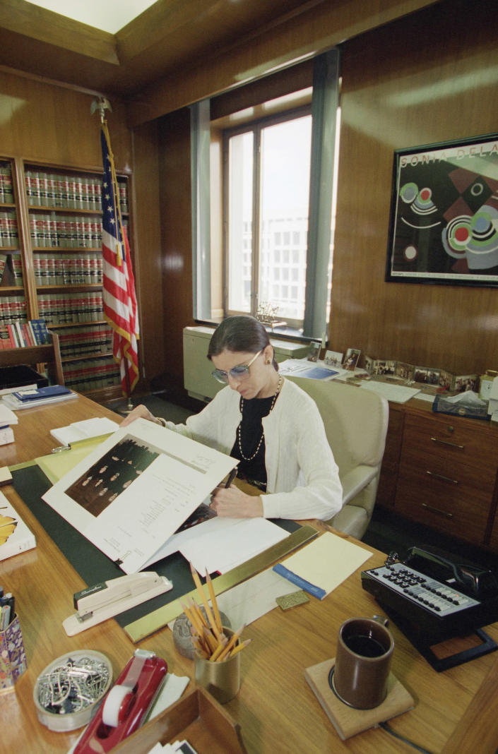 Supreme Court nominee Judge Ruth Bader Ginsburg works in her Washington office. The Senate Judiciary Committee voted unanimously to endorse the federal appeals judge's nomination to sit on the high court. Full Senate confirmation followed, making her the 107th justice and the second woman on the U.S. Supreme Court. (Photo: Doug Mills/AP)