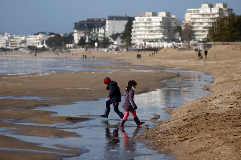 Children play on the beach of La Baule