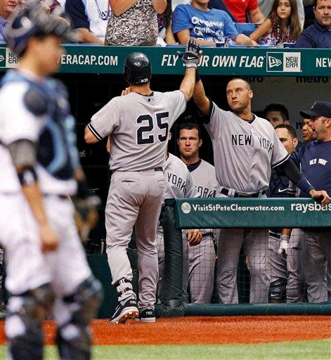 New York Yankees' Mark Teixeira (25) is congratulated by Derek Jeter after his home run during the seventh inning of a baseball game, Wednesday, July 4, 2012, in St. Petersburg, Fla. (AP Photo/Mike Carlson)