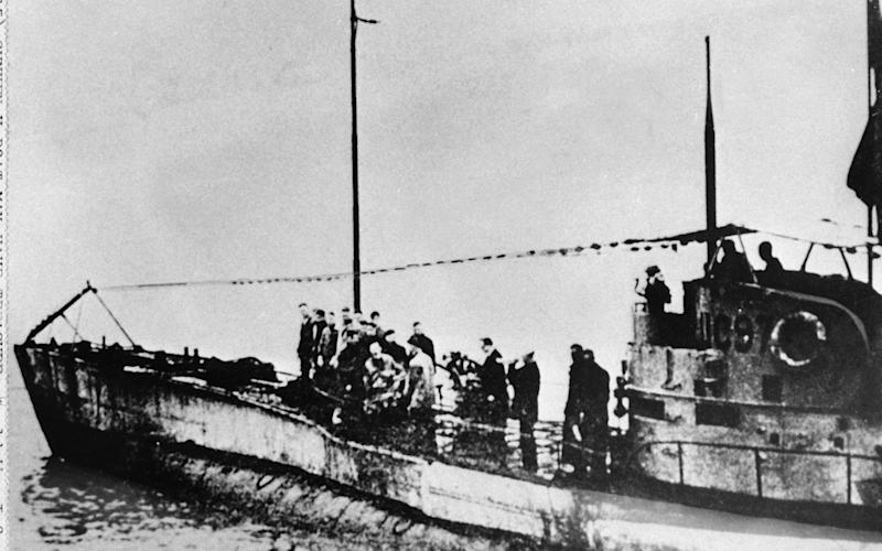 In this undated photo people stand on the deck of a World War I German submarine type UC-97 in an unknown location. - AP