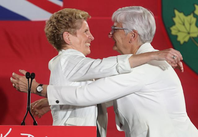 Ontario Premier Kathleen Wynne hugs her partner Jane Rounthwaite after voting closed in provincial elections during her campaign event in Toronto, Ontario, Canada June 7, 2018. REUTERS/Fred Thornhill