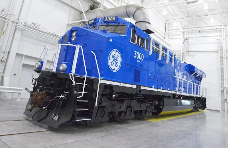 This photo from Sept. 14, 2013, which was provided by General Electric, shows an experimental natural gas locomotive in Erie, Pennsylvania. The diesel locomotives that became freight railroads' workhorse after World War II could be replaced in the next few years by units like this that burn a mix of natural gas and diesel. The switch could likely reduce fuel costs and pollution significantly while allowing railroads to take advantage of abundant domestic supplies of natural gas. But many questions about using natural gas locomotives remain unanswered, and those could easily derail the idea. (AP Photo/General Electric, Mark Fainstein)