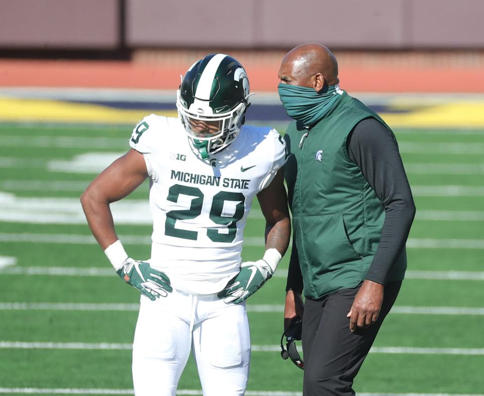 Michigan State Spartans coach Mel Tucker talks with cornerback Shakur Brown after a taunting penalty during the third quarter at Michigan Stadium in Ann Arbor, Saturday, Oct. 31, 2020.