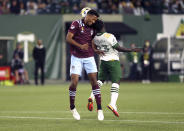 Portland Timbers midfielder Yimmi Chara, right, collides with Colorado Rapids' Auston Trusty on a header during an MLS soccer match, Wednesday, Sept. 15, 2021 in Portland, Ore. (Sean Meagher/The Oregonian via AP)