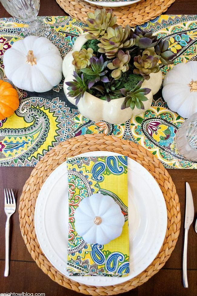 "<p>Complement energetic paisley table linens with a creative succulent centerpiece. Just paint your carved pumpkin white and fill it with the succulents of your choice. <br></p><p><em><a href=""https://www.anightowlblog.com/thanksgiving-tablescape-succulent-centerpiece/"" rel=""nofollow noopener"" target=""_blank"" data-ylk=""slk:Get the tutorial at A Night Owl Blog »"" class=""link rapid-noclick-resp"">Get the tutorial at A Night Owl Blog »</a></em></p>"