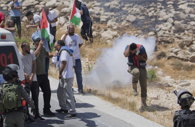 FILE - In this Aug. 16. 2019, file photo, Israeli border police disperse Palestinian, Israeli and foreign activists during a rally protesting a newly established settlement near the West Bank village of Kufr Malik, east of Ramallah. As President Donald Trump presented a Mideast plan favorable to Israel, Prime Minister Benjamin Netanyahu on Tuesday, Jan. 28, announced plans to move ahead with the potentially explosive annexation of large parts of the occupied West Bank, including dozens of Jewish settlements. (AP Photo/Nasser Nasser, File)