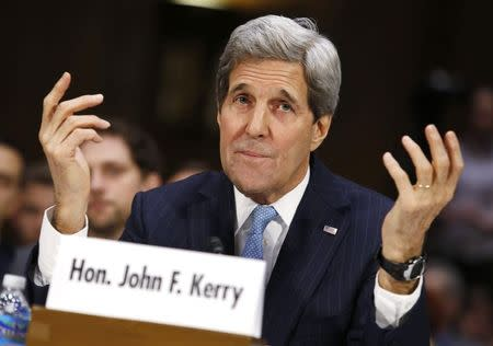 """U.S. Secretary of State John Kerry testifies before a Senate Foreign Relations Committee hearing on """"Authorization for the Use of Military Force Against ISIL"""" on Capitol Hill in Washington December 9, 2014. REUTERS/Yuri Gripas"""