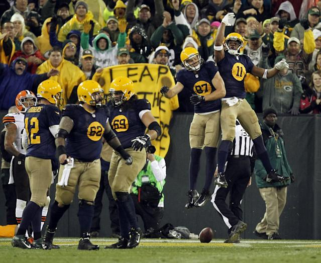 Green Bay Packers' Jordy Nelson (87) celebrates his touchdown catch with teammate Jarrett Boykin (11) during the second half of an NFL football game against the Cleveland Browns Sunday, Oct. 20, 2013, in Green Bay, Wis. The Packers won 31-13. (AP Photo/Mike Roemer)