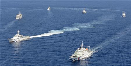 Vessels from the China Maritime Surveillance and the Japan Coast Guard near disputed islands, called Senkaku in Japan and Diaoyu in China, in the East China Sea