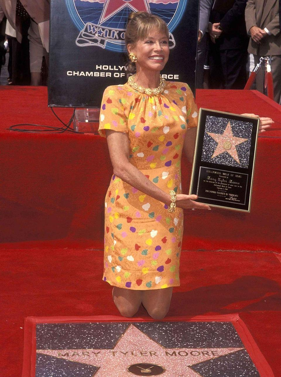 <p>Moore receives a star on the Hollywood Walk of Fame.</p>