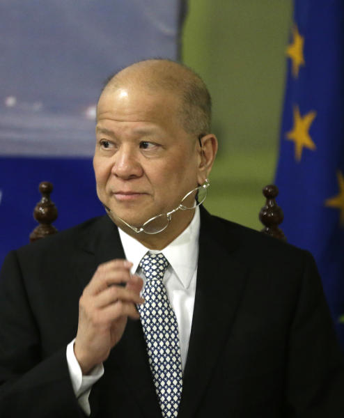Ramon Ang, President and CEO of Philippine Airlines, the nation's flag carrier, prepares to answer a question at a news conference Wednesday July 10, 2013 in Manila, Philippines to announce the lifting of the ban of Philippine Airlines to fly to Europe. The European Union has partially lifted a ban on the entry of Philippine planes after aviation authorities in Manila addressed safety concerns, removing an obstacle to a robust flow of tourists and trade between Europe and the Southeast Asian nation, officials said Wednesday. (AP Photo/Bullit Marquez)