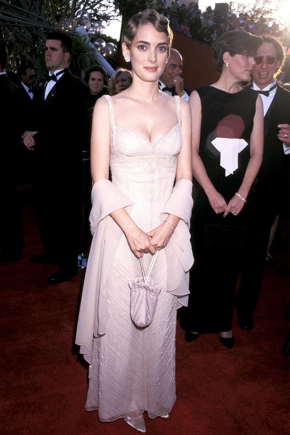 """<strong><h2>Winona Ryder, 1996</h2></strong><br>While we're used to seeing '90s-era Winona Ryder donning all-black ensembles, it was an unexpected surprise to see her donning this champagne-colored vintage gown.<br><br><em>Winona Ryder in a vintage champagne gown. </em><span class=""""copyright"""">Photo: Jim Smeal/WireImage/Getty Images. </span>"""