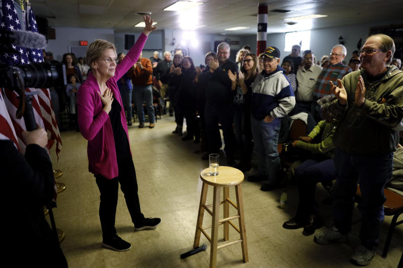 Democratic presidential candidate Sen. Elizabeth Warren, D-Mass., waves to audience members at the end of a town hall meeting, Monday, Dec. 16, 2019, in Keokuk, Iowa. (AP Photo/Charlie Neibergall)
