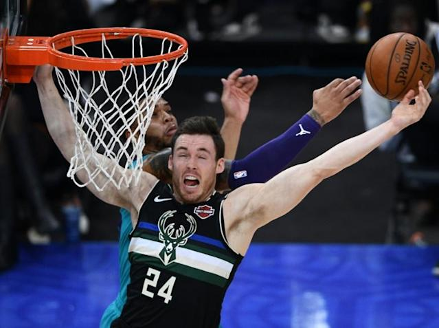 Milwaukee's Pat Connaughton, front, isn't sure when the Bucks will allow individual workouts at the team facility but the NBA is planning to allow it starting Friday in areas where governments permit such solo exercise sessions (AFP Photo/Anne-Christine POUJOULAT)