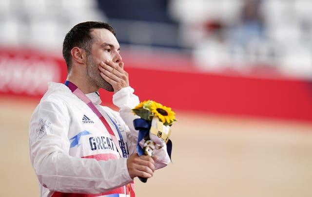 Matt Walls celebrates claiming Britain's first cycling gold of the Tokyo Games
