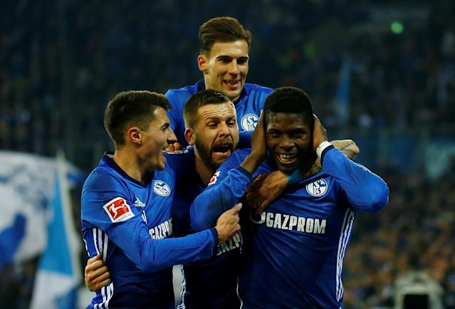 Soccer Football - Bundesliga - Schalke 04 vs TSG 1899 Hoffenheim - Veltins-Arena, Gelsenkirchen, Germany - February 17, 2018 Schalke's Breel Embolo celebrates with team mates after scoring but his goal is subsequently disallowed after consultation with the video assistant referee REUTERS/Leon Kuegeler DFL RULES TO LIMIT THE ONLINE USAGE DURING MATCH TIME TO 15 PICTURES PER GAME. IMAGE SEQUENCES TO SIMULATE VIDEO IS NOT ALLOWED AT ANY TIME. FOR FURTHER QUERIES PLEASE CONTACT DFL DIRECTLY AT + 49 69 650050 TPX IMAGES OF THE DAY