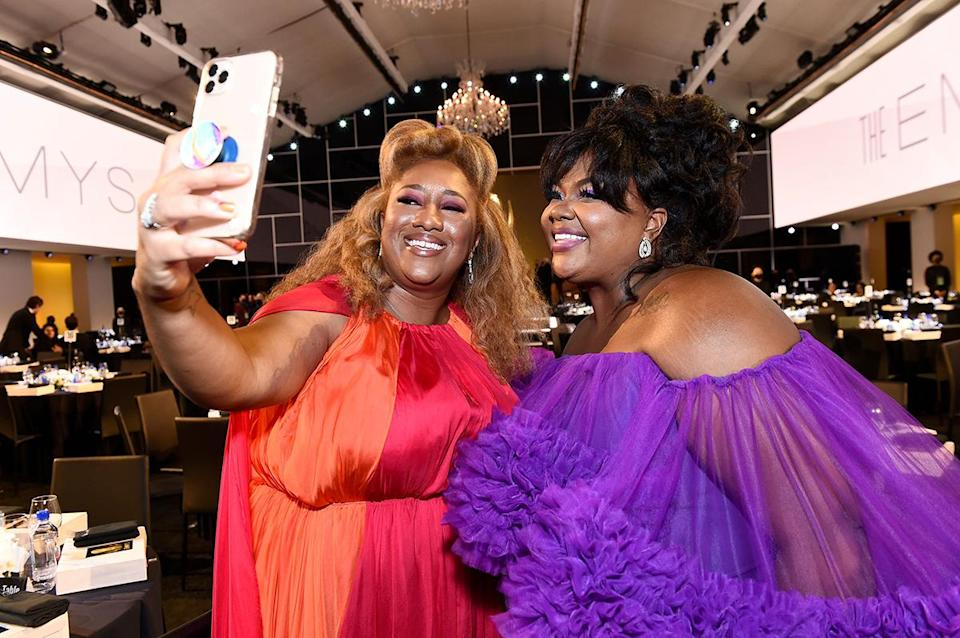 <p>Ashley Nicole Black and Nicole Byer smiled for a selfie inside the biggest night in television. </p>