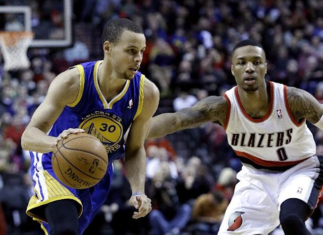 Golden State Warriors guard Stephen Curry, left, drives past Portland Trail Blazers guard Damian Lillard during the first half of an NBA basketball game in Portland, Ore., Sunday, March 16, 2014. (AP Photo/Don Ryan)