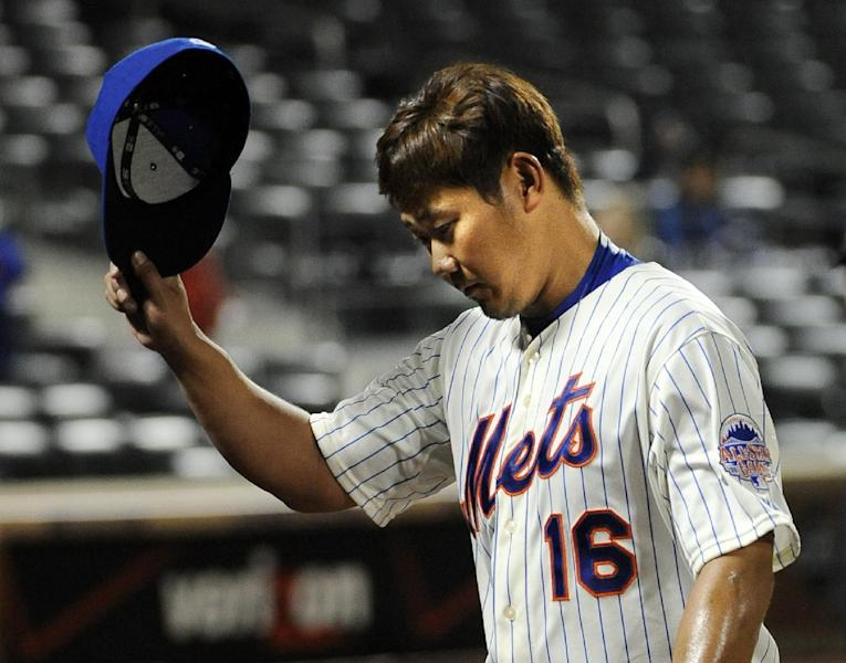 New York Mets starting pitcher Daisuke Matsuzaka tips his cap to the fans after being taken ou in the top of the eighth of Game 2 of a baseball doubleheader against the Miami Marlins at Citi Field, Saturday, Sept. 14, 2013, in New York. (AP Photo/Kathy Kmonicek)