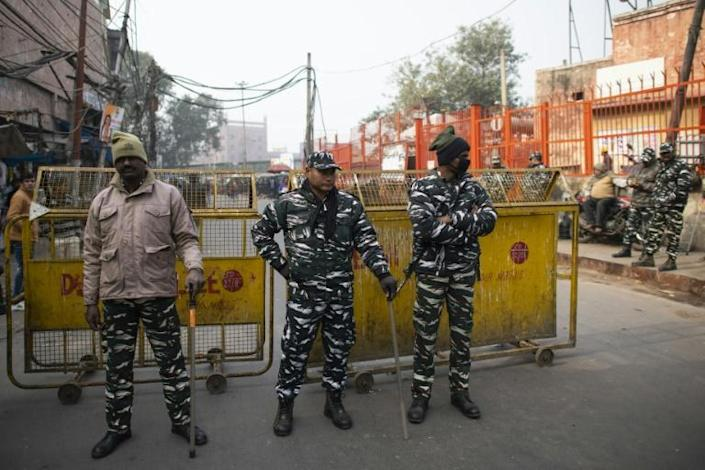 Riot police and paramilitary troops erected steel barricades on roads leading to the mosque in old Delhi (AFP Photo/Jewel SAMAD)
