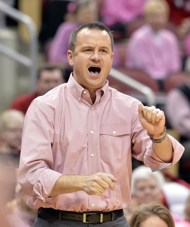 Louisville head coach Jeff Walz shouts instructions to his team during the first half of an NCAA college basketball game against Rutgers, Sunday, Feb. 23, 2014, in Louisville, Ky. (AP Photo/Timothy D. Easley)