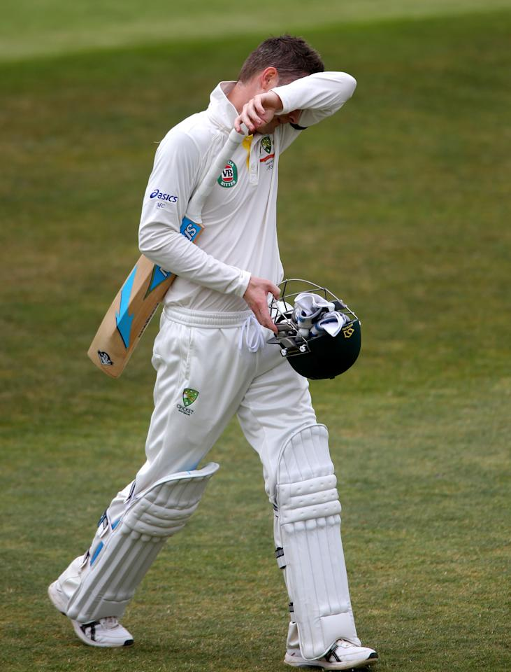 Australia captain Michael Clarke shows his dejection after he was out for 45 during the International Tour match at the County Ground, Taunton.