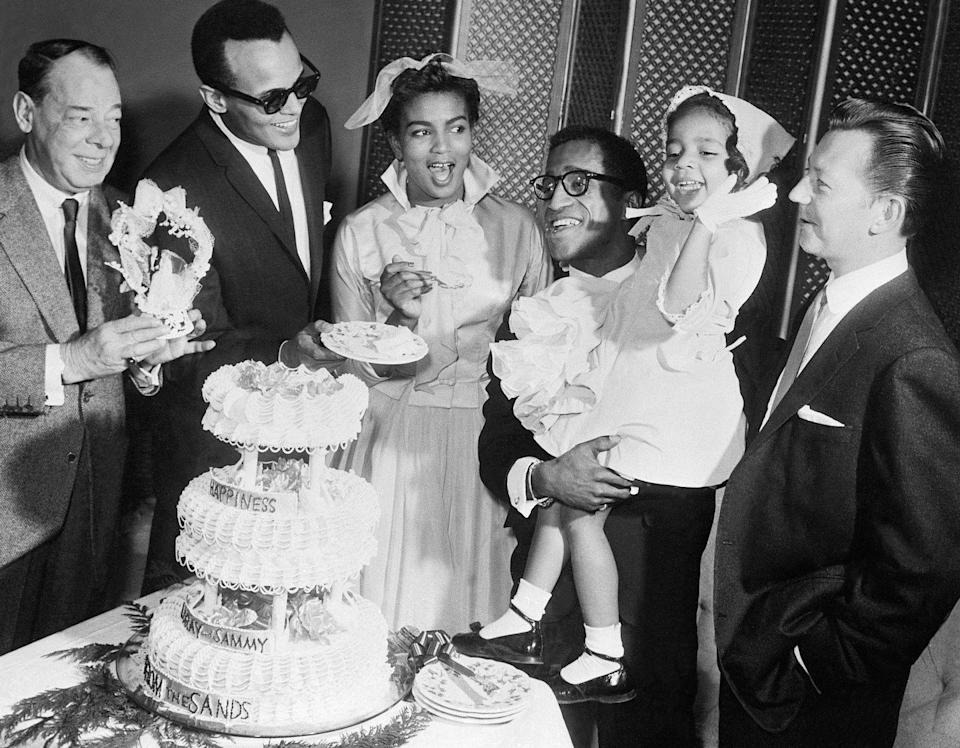 """<p>Rat pack crooner Sammy Davis Jr. married <a href=""""https://www.smithsonianmag.com/arts-culture/hollywood-loved-sammy-davis-jr-until-he-dated-white-movie-star-180964395/"""" rel=""""nofollow noopener"""" target=""""_blank"""" data-ylk=""""slk:his first wife, actress Loray White"""" class=""""link rapid-noclick-resp"""">his first wife, actress Loray White</a>, on January 10, 1958 at the Sands Hotel in Las Vegas. The actress wore a white collared A-line dress with tulle ribbon in her hair. They were joined by famous friends, such as Jerry Lewis and Harry Belafonte. Their marriage lasted less than one year and they divorced in 1959. </p>"""