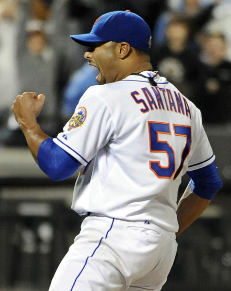 FILE - In this June 1, 2012, file photo, New York Mets starting pitcher Johan Santana celebrates after throwing a no-hitter against the St. Louis Cardinals in a baseball game at Citi Field in New York. The Mets say Santana has injured his left shoulder again and likely will need surgery and miss the 2013 season. (AP Photo/Kathy Kmonicek, File)
