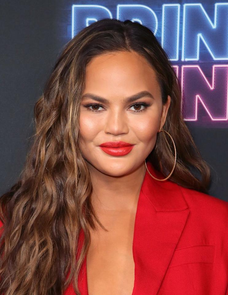 <p>Teigen serving up a fiery hot look with long layers and soft waves.</p>