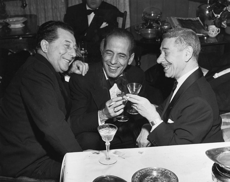 <p>Naturally, this Hollywood heavy hitter brought out his formalwear for the holidays. Bogart wore a sharp tuxedo for drinks with Hollywood pals at a Christmas Eve party in 1951.</p>