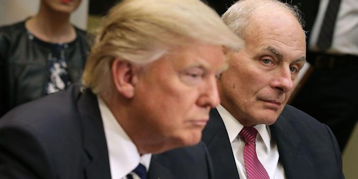 Donald Trump leaning forward in front of John Kelly.