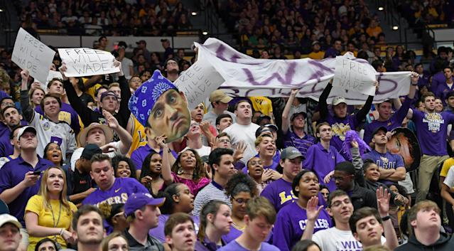 LSU students wave signs and banners supporting embattled head coach Will Wade. (AP File Photo/Bill Feig)