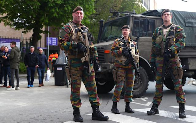 <span>Belgian security forces patrol outside the stadium in numbers after Tuesday's bomb attack in Dortmund</span> <span>Credit: Clive Rose/Getty Images </span>