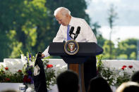 President Joe Biden takes off his jacket while speaking during a news conference after meeting with Russian President Vladimir Putin, Wednesday, June 16, 2021, in Geneva, Switzerland. (AP Photo/Patrick Semansky)
