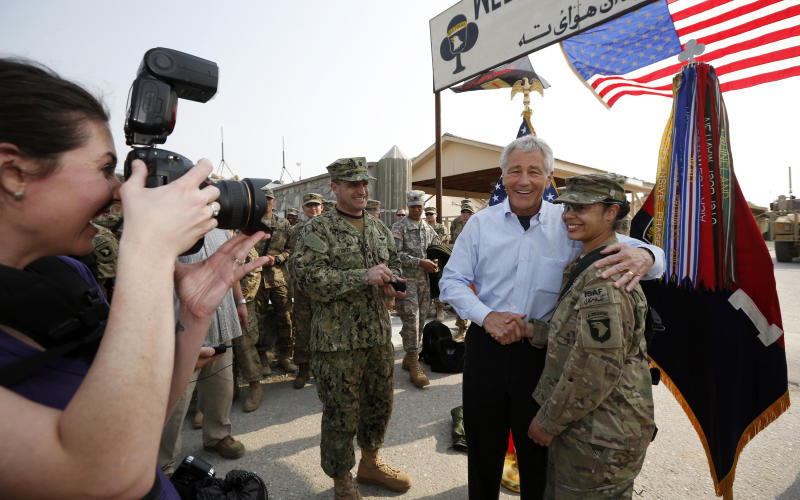 U.S. Defense Secretary Chuck Hagel poses for a picture with a member of the U.S. Army 101st Airborne Division during his visit to Jalalabad Airfield in eastern Afghanistan, Saturday, March 9, 2013. It is Hagel's first official trip since being sworn-in as President Barack Obama's defense secretary. (AP Photo/Jason Reed, Pool)