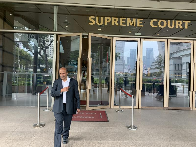 Singapore Democratic Party chairman Paul Tambyah emerges from the High Court. PHOTO: Nicholas Yong/Yahoo News Singapore