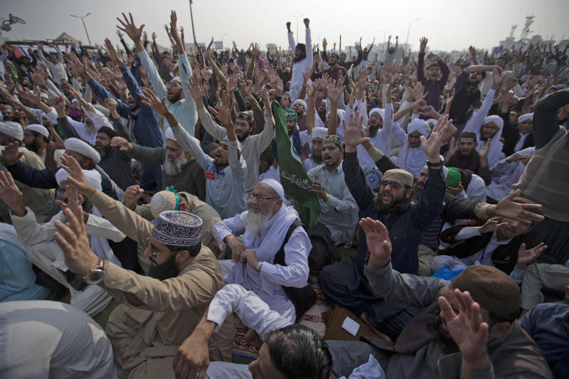 Supporters of Pakistani radical religious party Tehreek-i-Labaik Ya Rasool Allah shout slogans during a sit-in protest in Islamabad, Pakistan, Friday, Nov. 10, 2017. Hundreds of Islamists have camped out on the edge of Pakistan's capital to demand the removal of the country's law minister over a recently omitted reference to the Prophet Muhammad in a constitutional bill. (AP Photo/B.K. Bangash)