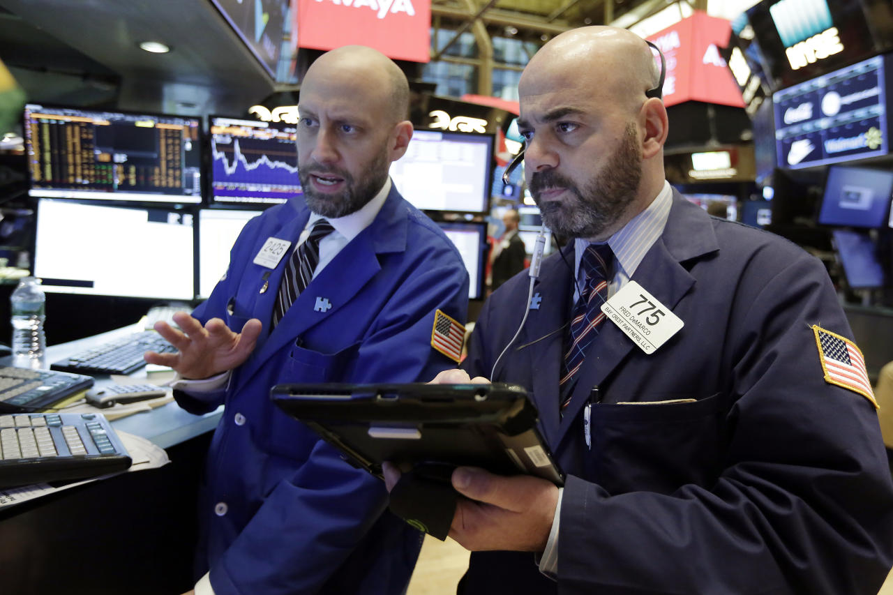<p> Specialist Meric Greenbaum, left, and trader Fred DeMarco work on the floor of the New York Stock Exchange, Wednesday, Jan. 17, 2018. Stocks are opening higher on Wall Street as the market makes up some of the ground it lost a day earlier. (AP Photo/Richard Drew) </p>