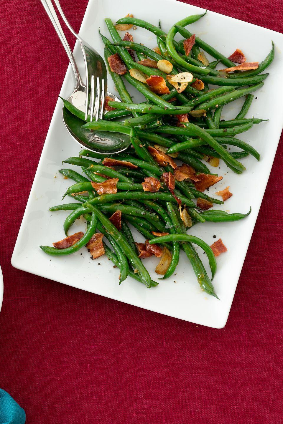 """<p>Ditch the green bean casserole for a dish of sweet and savory contradictions in the form of apricot jam and smoky bacon.</p><p><a href=""""https://www.womansday.com/food-recipes/food-drinks/recipes/a11697/apricot-glazed-green-beans-recipe-wdy1112/"""" rel=""""nofollow noopener"""" target=""""_blank"""" data-ylk=""""slk:Get the Apricot-Glazed Green Beans recipe."""" class=""""link rapid-noclick-resp""""><em><strong>Get the Apricot-Glazed Green Beans recipe.</strong></em></a></p>"""