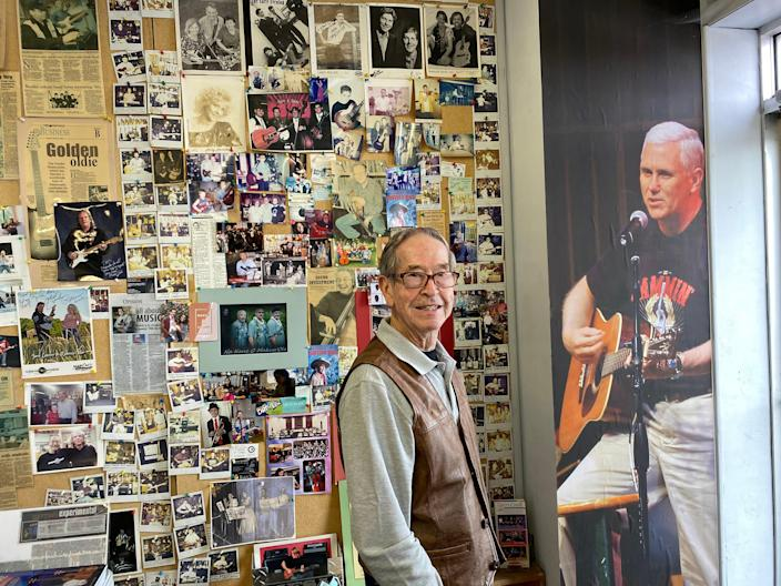 <p>Tom Pickett, who taught Pence how to play the guitar in high school, has a life-size photograph of the former VP in his music shop in Columbus</p> (Richard Hall / The Independent )