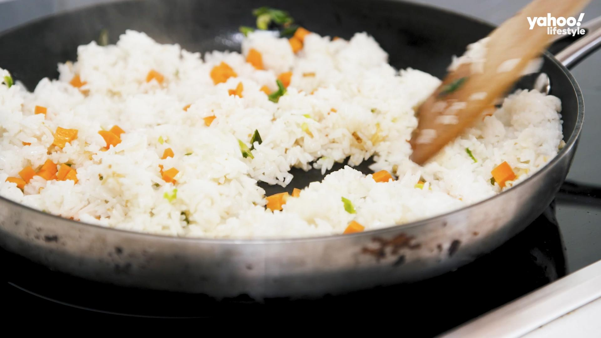 Add rice and using a wooden spoon break up any clumps and combine well with ginger and garlic mix.