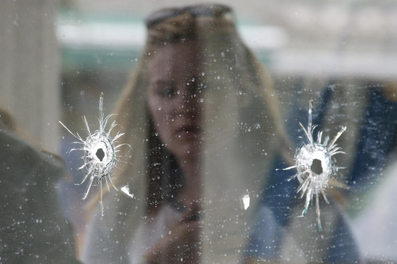 Bullet holes where a mass shooting took place near the University of California, Santa Barbara, campus