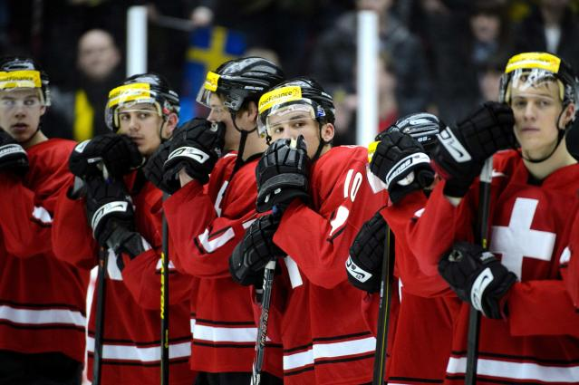 Switzerland's players react after losing their qualification round match against Sweden at the International Ice Hockey Federation (IIHF) World Junior Hockey Championships in Malmo December 26, 2013. REUTERS/Ludvig Thunman/TT News Agency (SWEDEN - Tags: SPORT ICE HOCKEY) ATTENTION EDITORS � THIS IMAGE WAS PROVIDED BY A THIRD PARTY. FOR EDITORIAL USE ONLY. NOT FOR SALE FOR MARKETING OR ADVERTISING CAMPAIGNS. SWEDEN OUT. NO COMMERCIAL OR EDITORIAL SALES IN SWEDEN. THIS PICTURE IS DISTRIBUTED EXACTLY AS RECEIVED BY REUTERS, AS A SERVICE TO CLIENTS