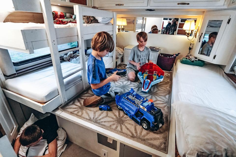 the children playing in their bedroom in the walker family RV