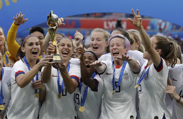 United States' team celebrates with trophy after winning the Women's World Cup final soccer match between US and The Netherlands at the Stade de Lyon in Decines, outside Lyon, France, Sunday, July 7, 2019. (AP Photo/Alessandra Tarantino)